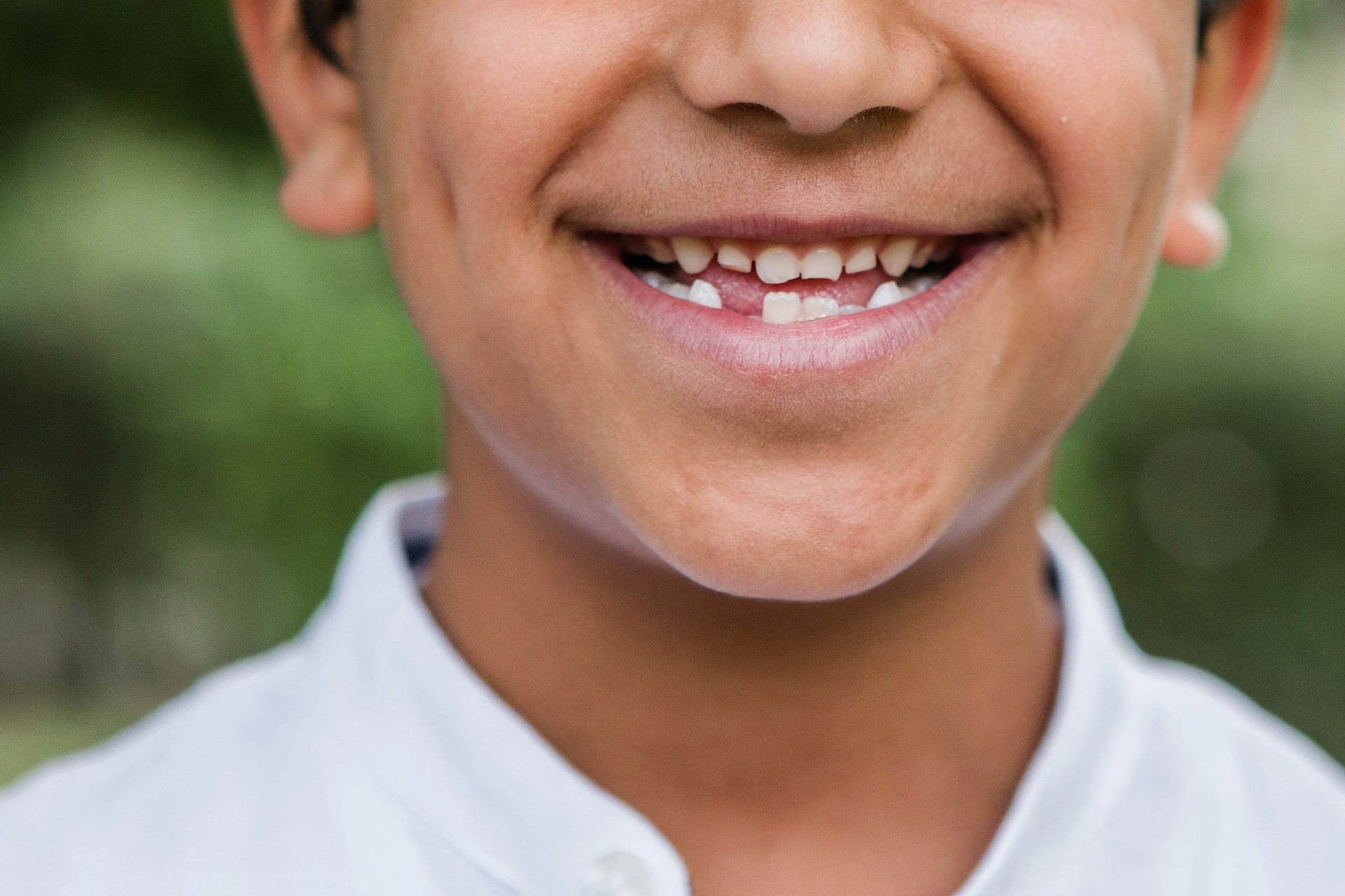 close up image of young boy's mouth