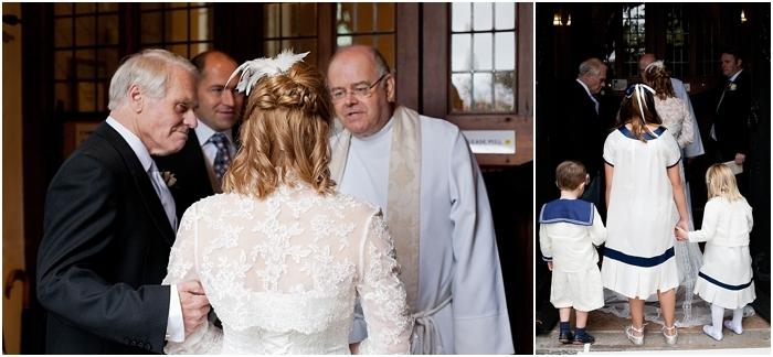 Bride, bridesmaids and page boy entering the church
