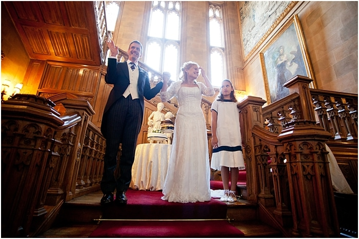 bride and groom on a grand staircase Highclere Castle Downton Abbey