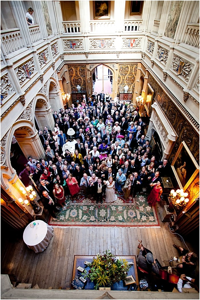 group shot of all wedding guests at Highclere Castle Downton Abbey saloon