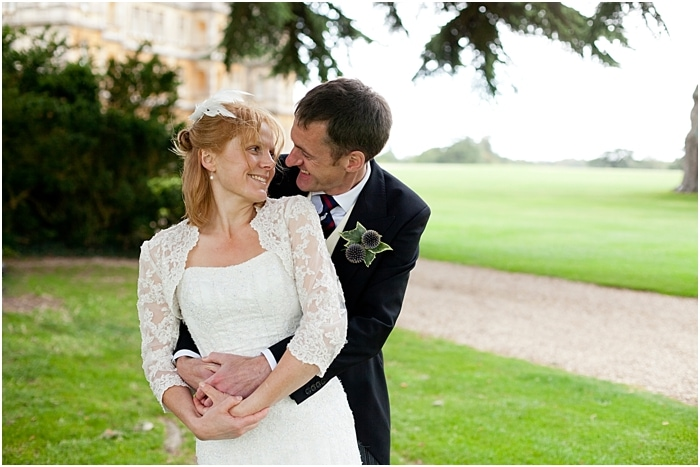 bride and groom portraits on the grounds of Highclere Castle Downton Abbey