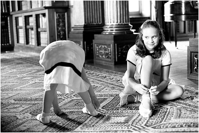 little bridesmaids playing on the floor at Highclere Castle