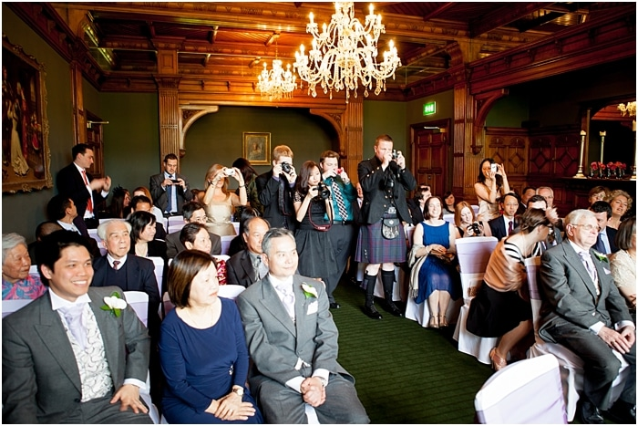 guests paparazzi at wedding ceremony
