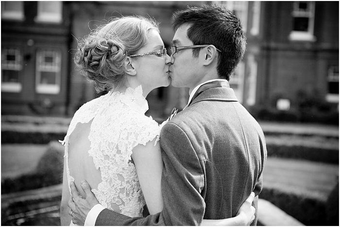 bride and groom kissing at woodlands park hotel