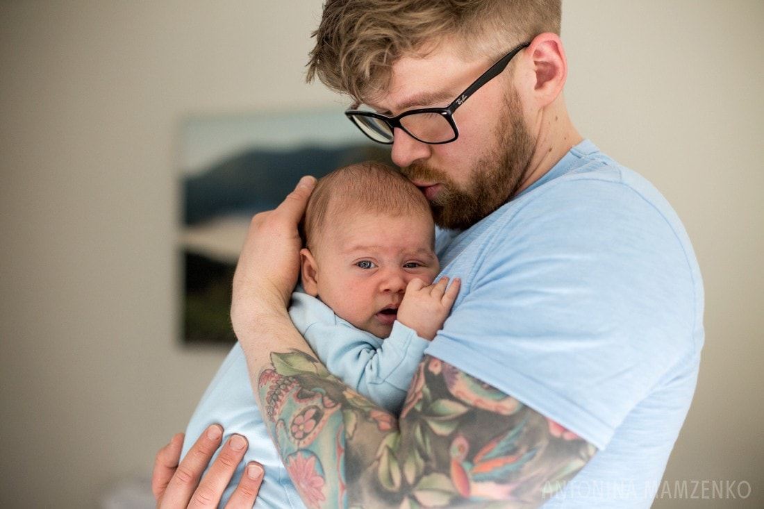 tattoed dad cuddling his newborn son at their home in fulham