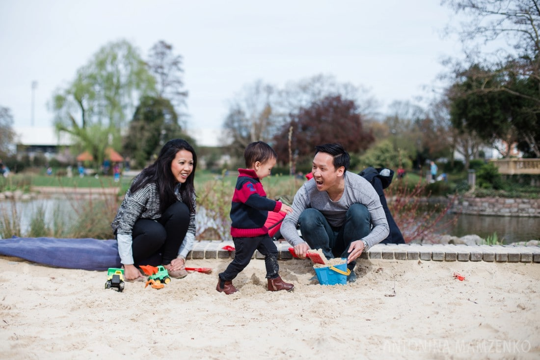 family playing at sandpit at bishop's park in fulham