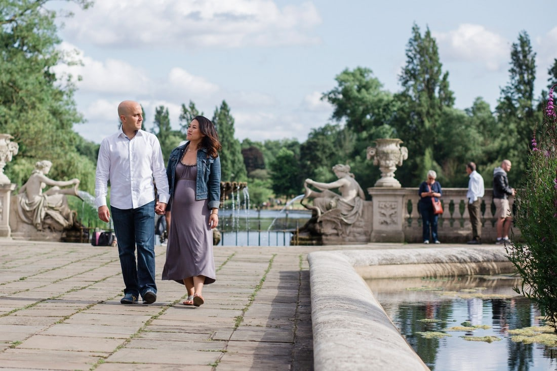 couple walking through italian gardens in hyde park