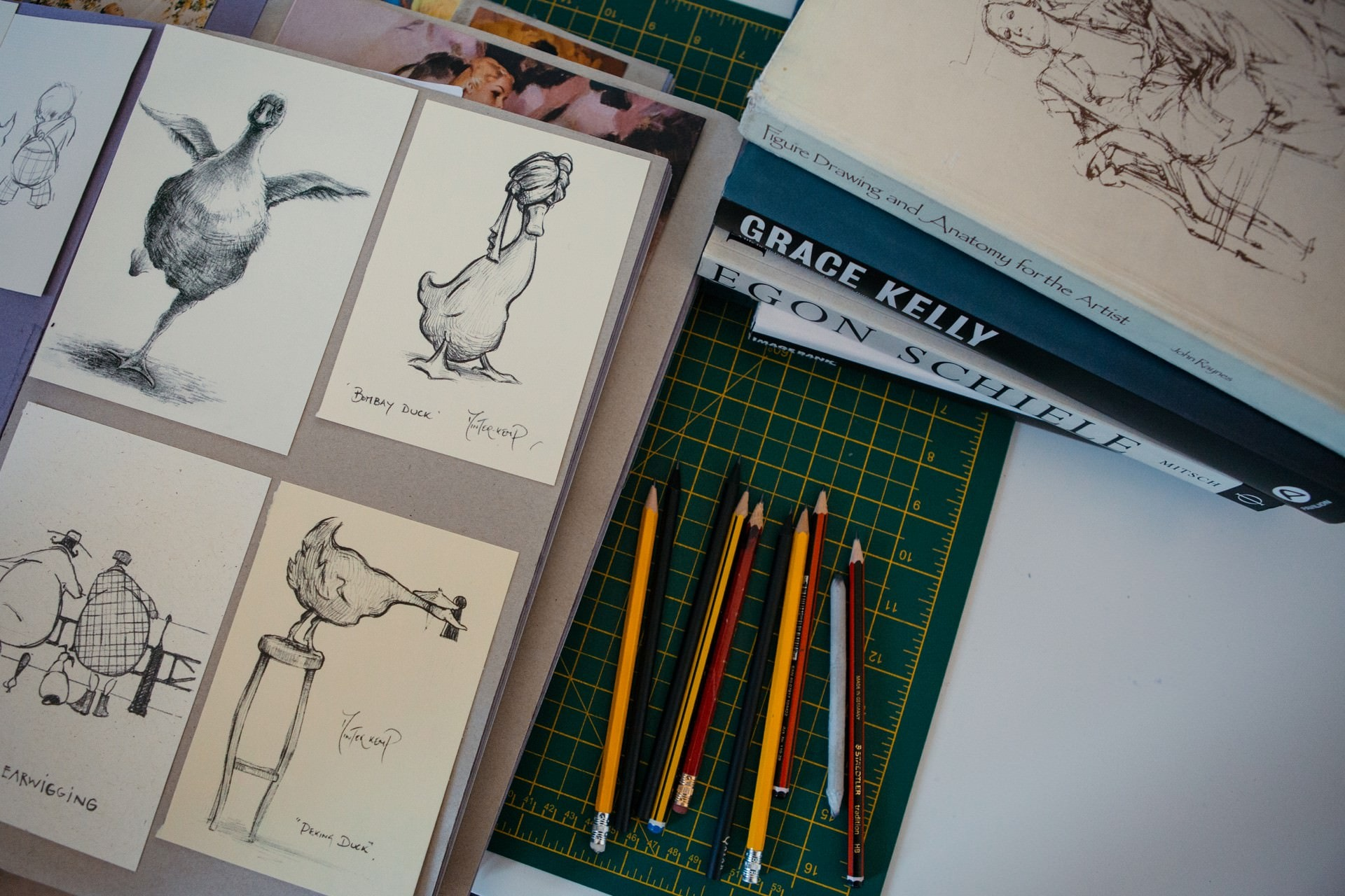 pencils and drawings on a table