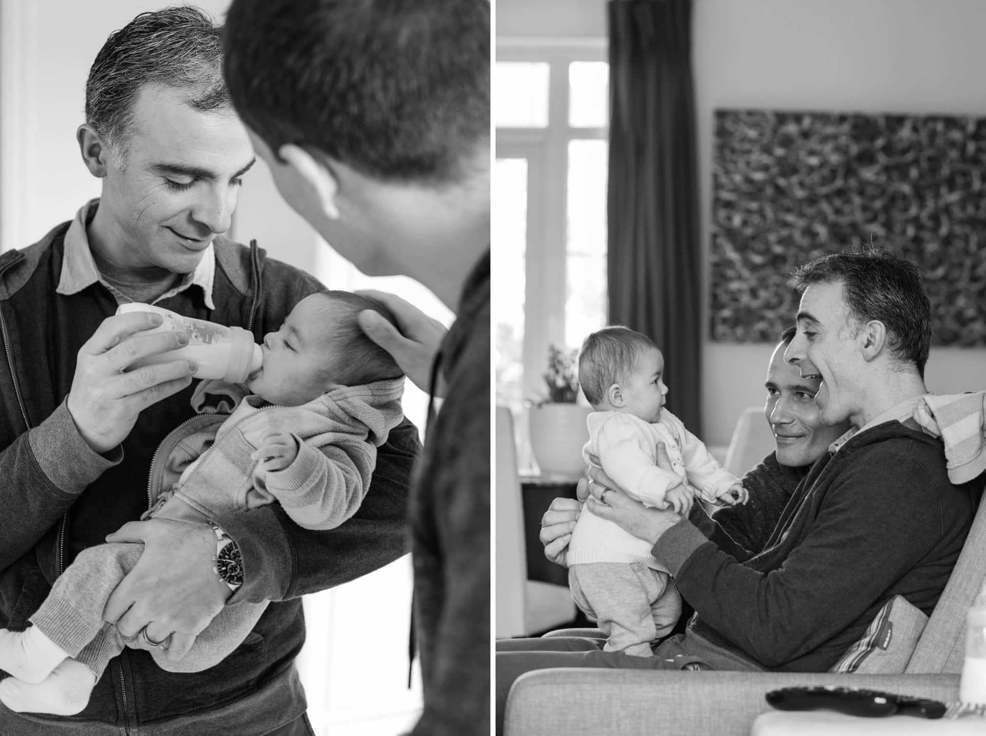 gay dads bottle feeding baby daughter in london