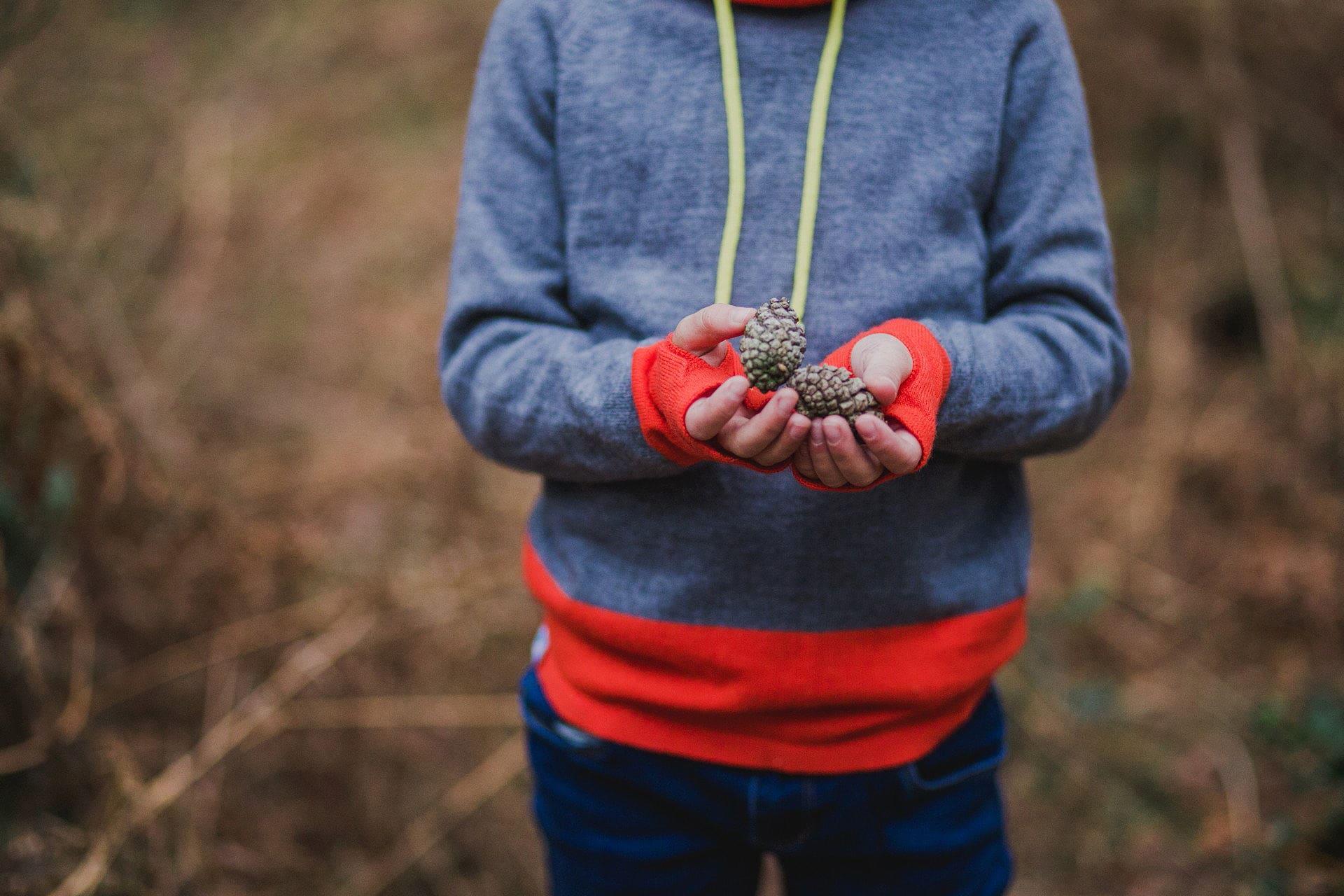 girl holding acorns