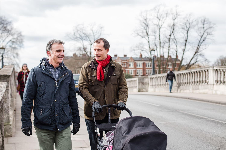 gay parents walking across Richmind Bridge