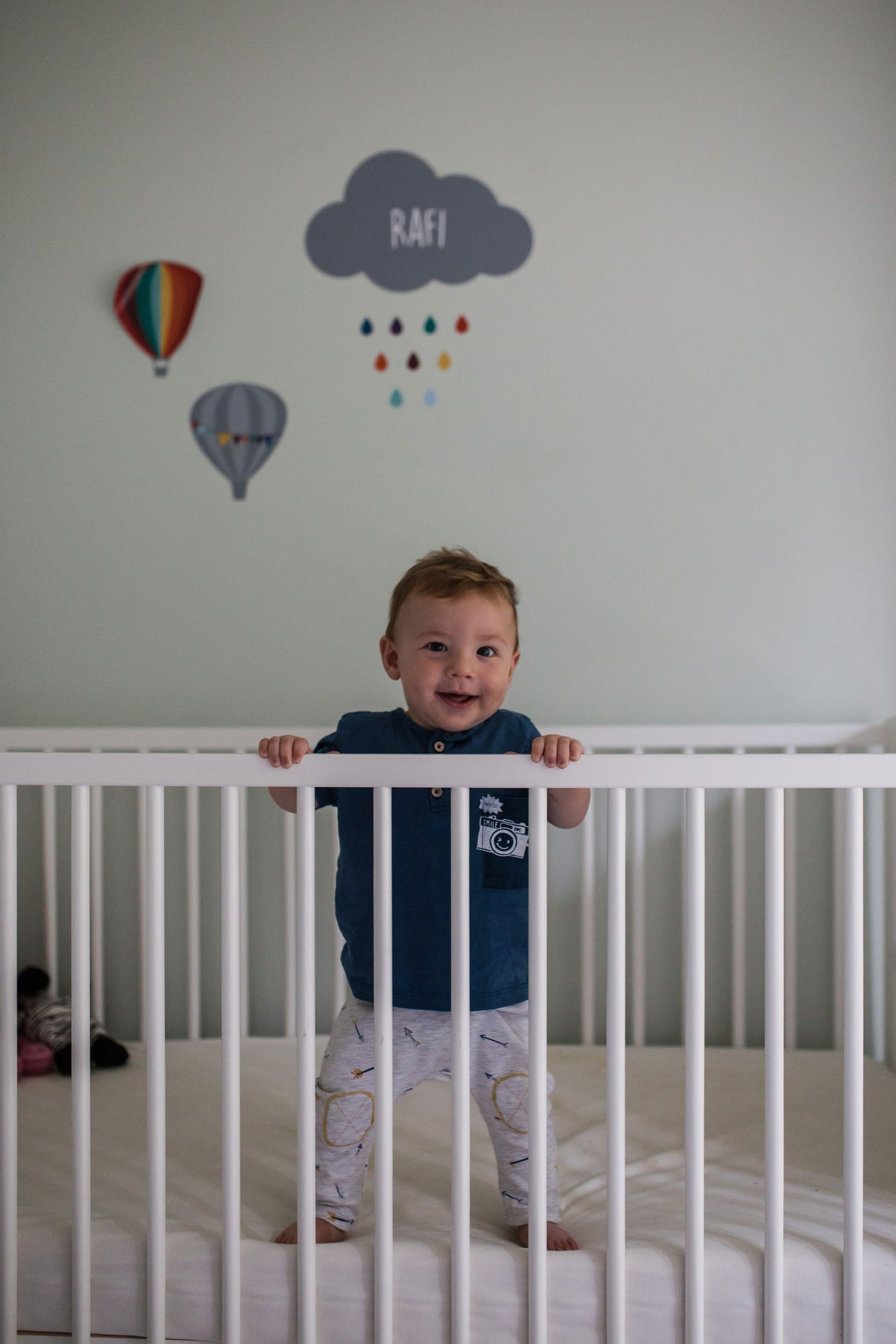 baby standing in his crib