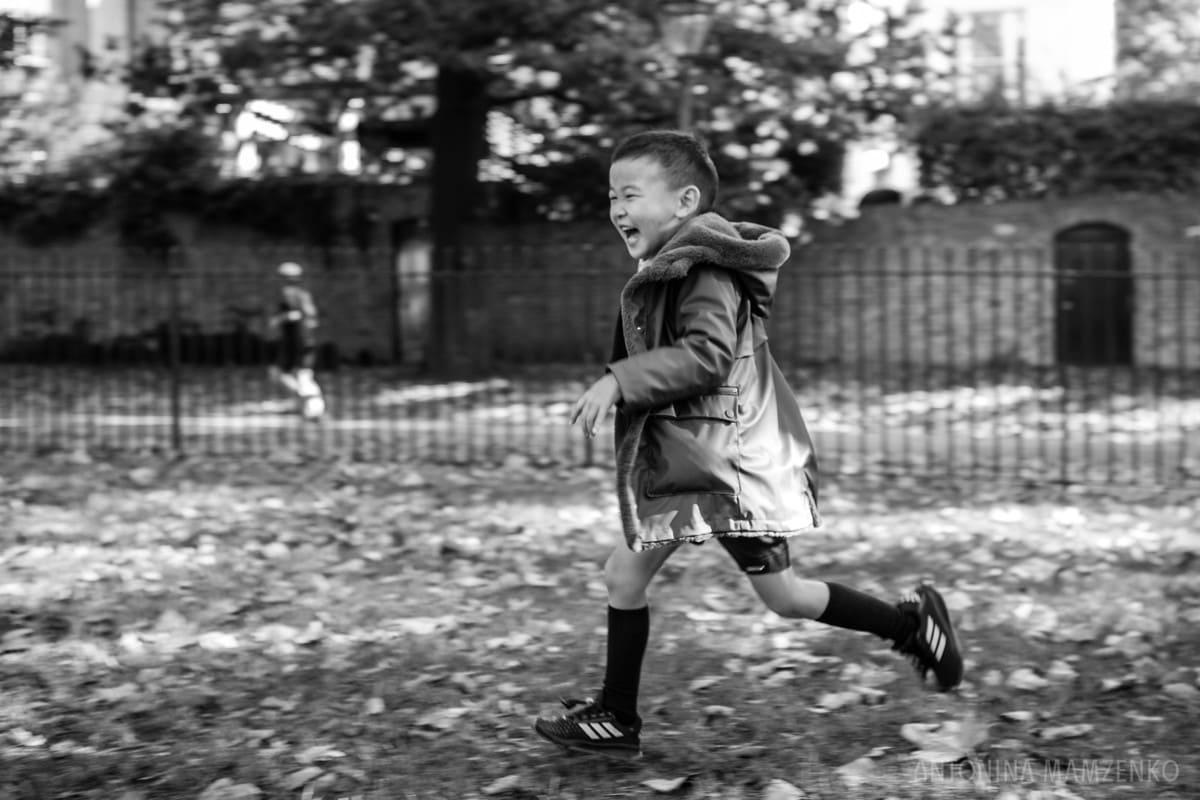 boy running though holland park