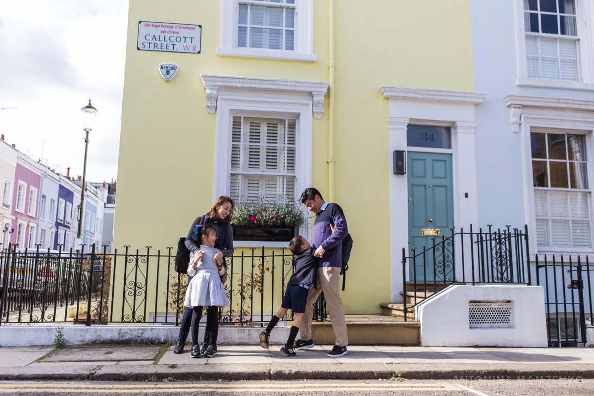 family looking at colourful houses in notting hill