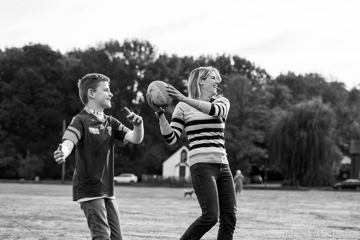 family playing rugby in esher common