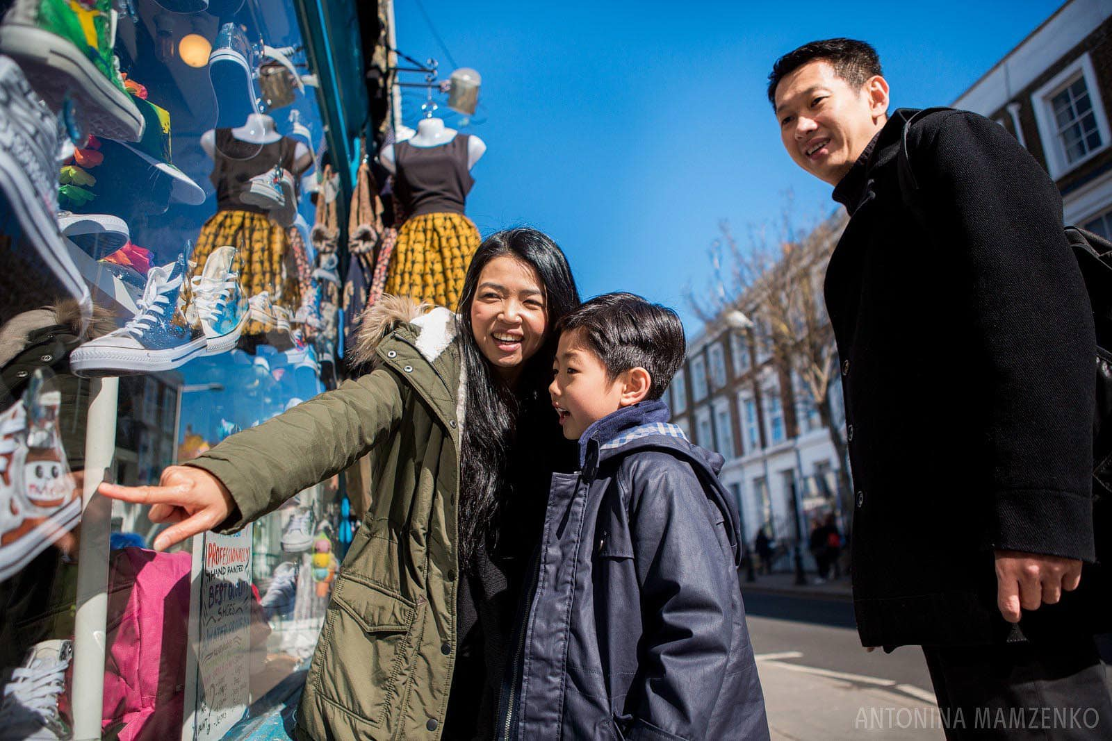 a family checking out Portobello Road shops in Notting Hill during their family photoshoot