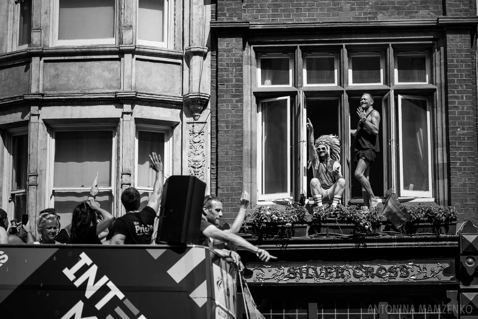 people celebrating London Pride 2018 dancing in windows of the building lining up Whitehall