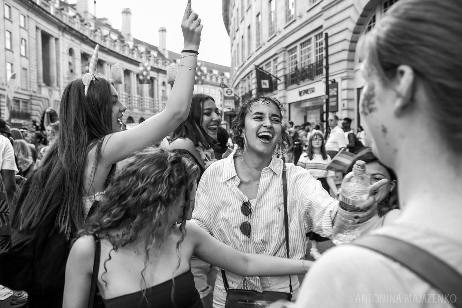 young women dancing on Regent's Street as part of London Pride parade 2018