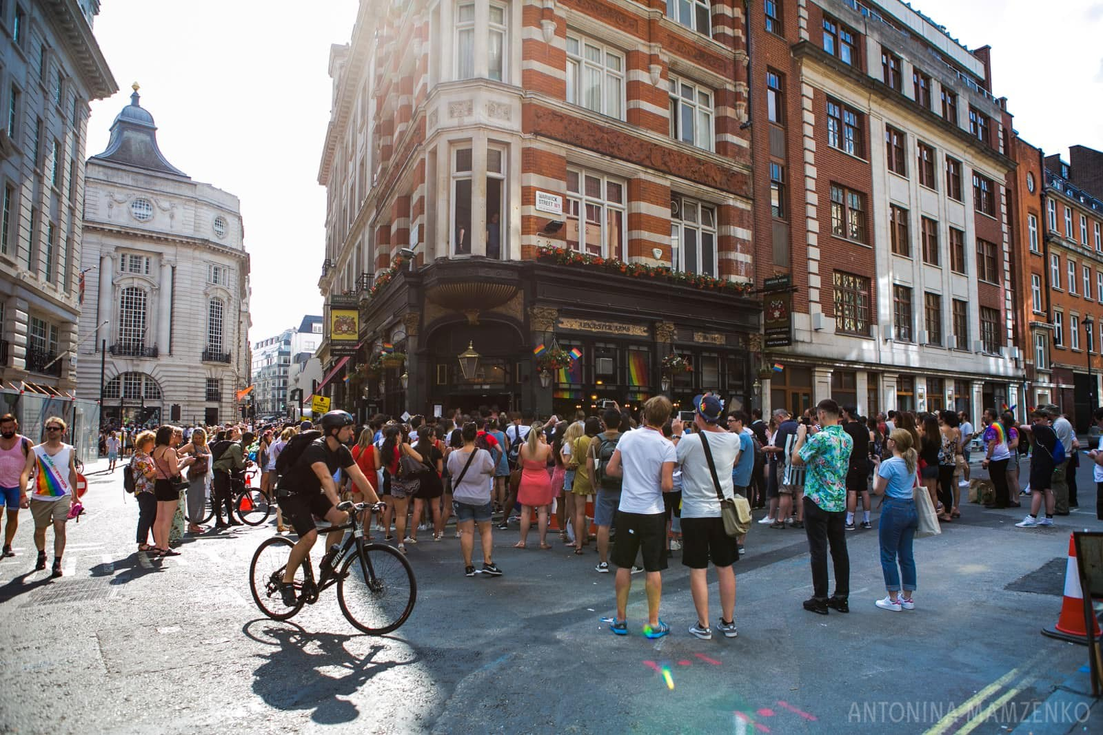 a crowd gathered outside a pub off Regent's Street to watch England win on 7th July, at London Pride