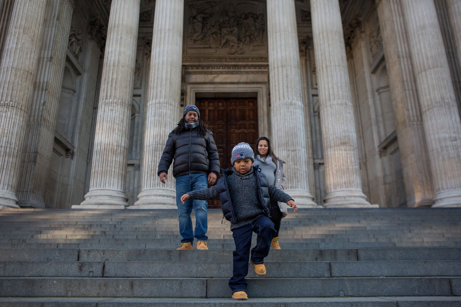 family exploring St Paul's Cathedral in London