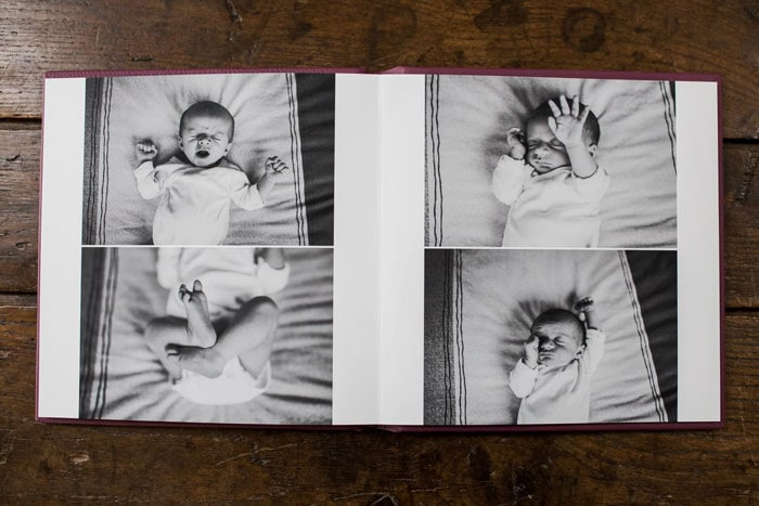 a photoalbum with newborn pictures of a baby sleeping